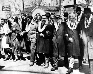 Abraham Joshua Heschel & Dr Martin Luther King Jr link arms in 1965 Selma march